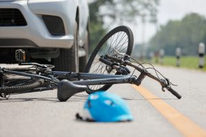 Bike Accident with car with helmet on road