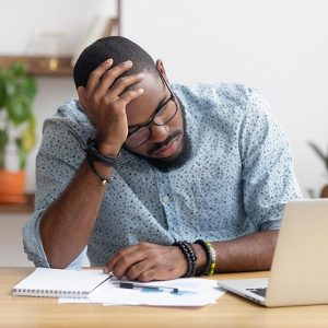 overwhelmed man reviewing insurance papers after truck accident